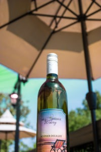 Bottle of Mill Bridge Winery's limited edition wine, Summer Delight.