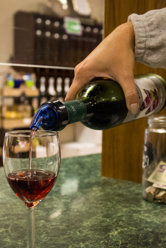 Wine being poured into glass.